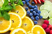image of infusion  - Sliced fresh organic fruits prepared to make infused water. ** Note: Shallow depth of field - JPG