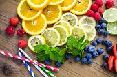 stock photo of infusion  - Sliced fresh organic fruits prepared to make infused water - JPG