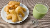 picture of dessert plate  - Snack and Dessert Chinese Traditional Snacks Deep Fried Doughstick on White Plate Served with Green Tea Soybean Milk - JPG
