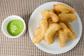 stock photo of dessert plate  - Snack and Dessert Chinese Traditional Snacks Deep Fried Doughstick on A White Plate Served with Pandan Coconut Custard Dip - JPG