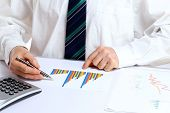 stock photo of anal  - calculate and write on a business document - JPG