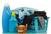 image of detergent  - Detergents with washing powder and clothes in basket on pale background - JPG