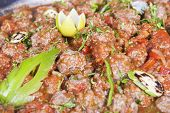 picture of meatball  - Egyptian beef meatballs in tomato sauce on display at a restaurant buffet - JPG