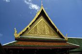 stock photo of gable-roof  - detail of the roof of an Asian temple with sky background - JPG