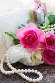 stock photo of mother-of-pearl  - fresh pink  roses with lace and pearls - JPG