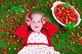 image of peeking  - Child eating strawberry - JPG