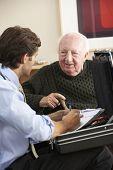 picture of visitation  - Doctor visiting senior man at home - JPG