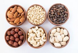picture of pine nut  - Six types of nuts in a round wooden form  - JPG