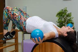 image of pilates  - Woman doing a pilates class during her pregnancy - JPG