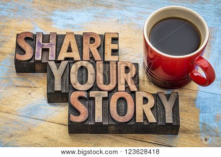 share your story  word abstract - inspirational text in vintage letterpress wood type with a cup of