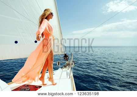 Luxury Woman Pareo Yachting In Sea With Blue Sky Sunlight