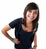 foto of braces  - Cute hispanic teenage girl with braces and a big smile while hand on hip - JPG