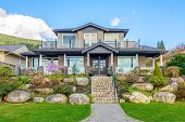 A very neat and colorful home with gorgeous outdoor landscape in suburbs of Vancouver, Canada poster