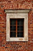 Window of a medieval building, very old brick wall