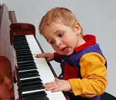 picture of children playing  - inspired little boy singing and playing piano - JPG