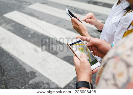 poster of Traveler use map on mobile phone app to search for route location of place with gps on street when travel in city,Technology in lifestyle