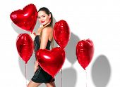 Valentine Beauty girl with red air balloons laughing, isolated on background. Beautiful Happy Young  poster