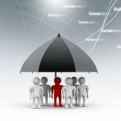 team standing with a black umbrella