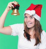 attractive young girl with christmas handbell