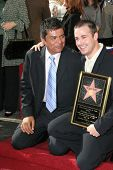 LOS ANGELES, CA - DEC 14: Freddie Prinze Jr; George Lopez at a ceremony where Freddie Prinze is honored with a posthumous star on the Hollywood Walk of Fame on December 14, 2004 in Los Angeles, CA