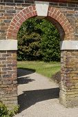 Arched Entrance In Brick Wall