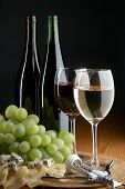 picture of wine grapes  - grape cheese and wine on the black background - JPG