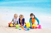 Kids On Tropical Beach. Children Playing At Sea. poster