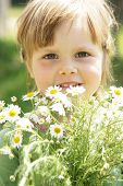 Little Girl With Daisies
