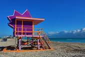The lifeguard stations on Miami Beach,Florida are designed with vibrant colors in the art deco style poster