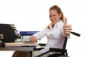 Happy Business Woman In Wheelchair Holding Thumbs Up