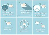 Greeting pastel blue cards with paper cut out doves and peace symbol for International Peace day. Fl poster
