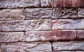 An old brick wall. The background is made of bricks. Pattern of the structure of a brick wall with m poster
