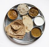 A thali is a selection of different dishes, usually served in small bowls on a round tray.
