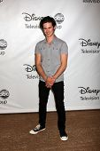 LOS ANGELES - AUG 7:  Connor Paolo arriving at the Disney / ABC Television Group 2011 Summer Press Tour Party at Beverly Hilton Hotel on August 7, 2011 in Beverly Hills, CA
