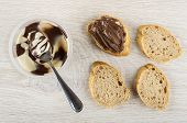 Spoon In Jar With Chocolate Paste, Slices Of Bread, Sandwich With Chocolate-nut Paste On Wooden Tabl poster