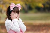 image of lolita  - japanese in sweet lolita cosplay in harajuku park - JPG