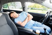 transport, rest and driving concept - tired man or driver sleeping in car poster