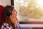 Young Woman In Headphones Enjoying Calm Music In Headphones poster
