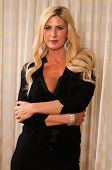 picture of blonde woman  - Beautiful mature blonde in a little black dress - JPG