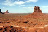 Cars Driving Through Monument Valley Arizona/Utah poster