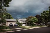 Thunderstorm clouds over a suburban neighborhood poster