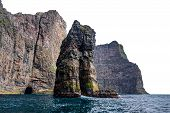Spectacular Rock Formations In Faroe Islands Coastline poster