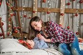 Baby And Mom On Christmas Background. Happy Family Mom And Child Little Daughter Son And Christmas M poster