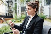 Pensive Business Woman In Cafe Sitting On Veranda Hold Digital Tablet And Drinking Juice. Beautiful  poster