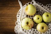 Cotton Net Bag With Fruits Apples On Dark Wooden Background . Sustainable Lifestyle. poster