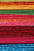 Colorful Beads Background. Background Pattern Of Multicolored Natural Stone Beads. String Of Beads I poster