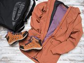 Womens Outwear, Footwear (brown Trench Jacket, Shuede Hiking Boots), Backpack.  Outfit For Traveling poster