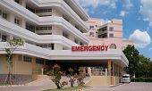 Modern Hospital Building With Ambulance Car And Entrance To Emergency Room At Hospital poster