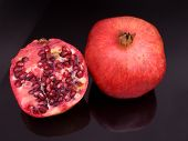 Pomegranates With One Cut Open,