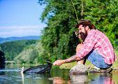 Man At Riverside Enjoy Peaceful Idyllic Landscape While Fishing. United With Nature. Fisherman Fishi poster